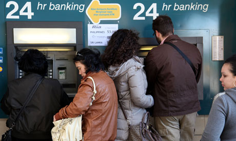 People try to withdraw money from a cashpoint machine in the Cypriot capital, Nicosia. The levy on Cypriot bank savers as part of the country's rescue package has been met with shock and fury. Photograph: Barbara Laborde/AFP/Getty Images for the Guardian.