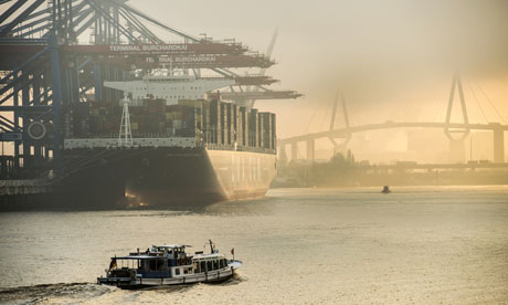 Container ship docks at Hamburg harbour