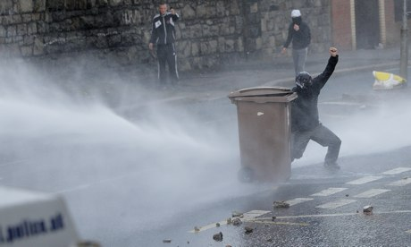 Police deploy a water cannon in Belfast