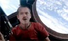 Commander Chris Hadfield performs David Bowie's 'Space Oddity' in space - video