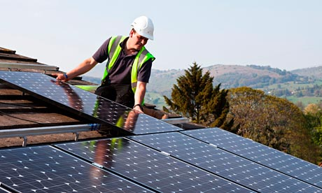 Fitting solar pv panels to house roof Wales UK