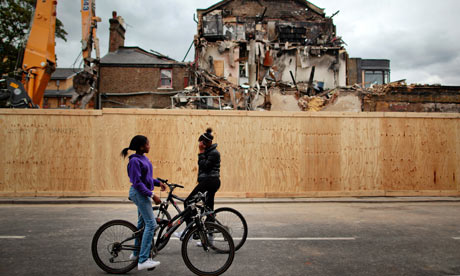 Local teenagers in front of burnt out buildings on Tottenham High Road