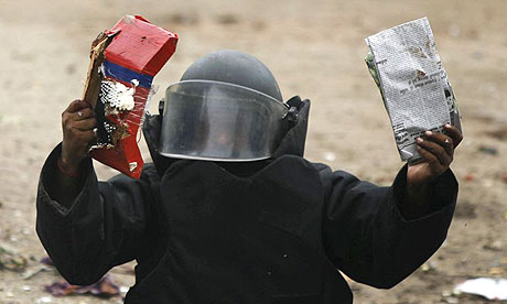 A bomb disposal expert holds up a bomb found in a rubbish bin after successfully defusing it in Ahmedabad, India. At least 45 people were killed in a series of up to 16 explosions across the city