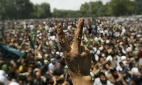 A Kashmiri Muslim shows a victory sign during a march in Srinagar, India