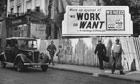 A large bill board discussing the need for more miners during the manpower shortage in 1947