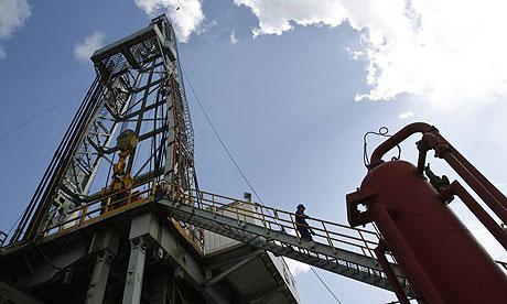A worker walks at an oil rig in Havana, Cuba