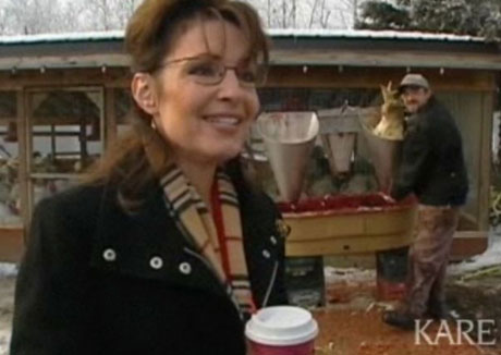 Sarah Palin with decapitated turkey in background; Photo Credit: AP/KARE-TV