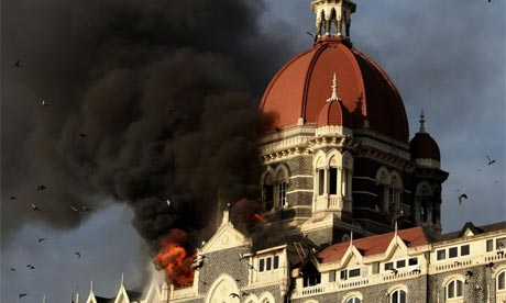 Smoke and flames pour from the Taj Mahal Hotel in Mumbai