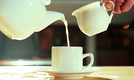 Pouring tea from a teapot