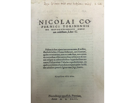 The frontispiece from a first edition of De Revolutionibus Orbi by Nicolaus Copernicus