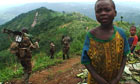 RDF troops marching through a village in Congo