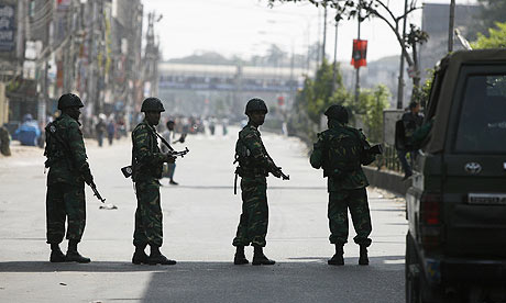 Soldiers patrol in front of the Bangladesh Rifles headquarters in Dhaka