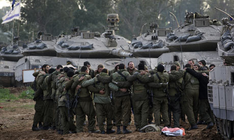 Israeli soldiers prepare to move towards northern Gaza