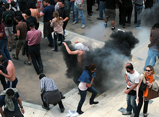 Strike in Greece: Riot policemen clash with protestors in the centre of Athens