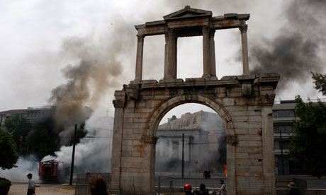 Smoke billows behind Hadrian's Arch and Acropolis during the protests this week.