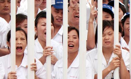 Chinese workers at Honda