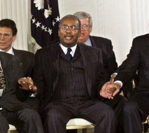 Jefferson Thomas (L) and Ernest Green (C) of the Little Rock Nine, with President Bill Clinton