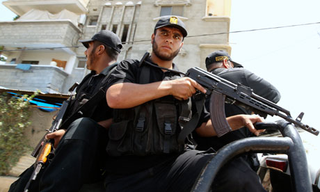 Hamas security forces ride a vehicle in Gaza