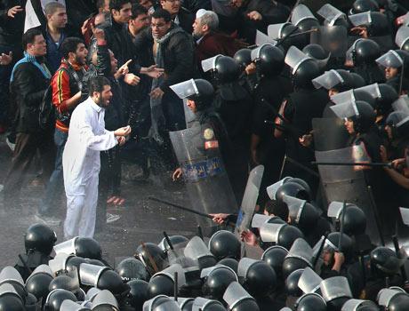 Riot police face protestors in Cairo