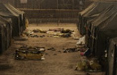 Iraqi detainees sleep outside tents in the Camp Bucca detention centre