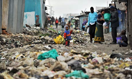 Outside the expat garden walls ... residents in the usual conditions of Nairobi's Mukuru-kwa-Njenga slum. Photograph: Tony Karumba/AFP/Getty Images