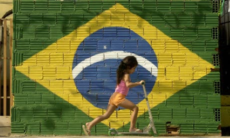 A young girl plays in Rio de Janeiro, which is to host the 2014 football World Cup and the 2016 Olympics. Photograph: Douglas Engle/AP