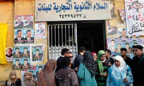 Egyptians cast their votes at a polling station in Cairo