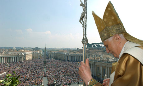 Pope Benedict XVI prepares to address a crowd from the central balcony of St Peter's Basilica