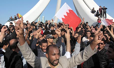 Bahraini protesters chant and wave flags in Egypt-style rebellion in the capital Manama