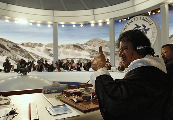 Muammar Gaddafi: July 2009: Giving a thumbs up at the G8 summit in L'Aquila, Italy