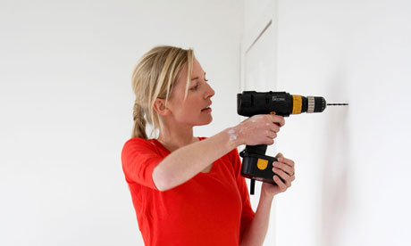 woman does diy electric drill