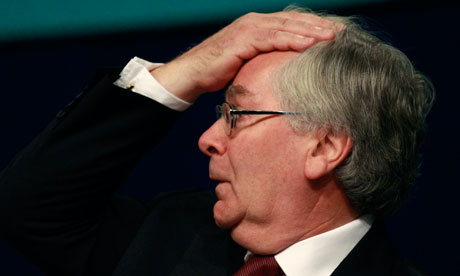 Bank of England Governor Mervyn King gestures after speaking during the TUC in Manchester