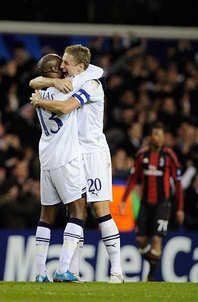 tottenham's michael dawson and william gallas celebrate their champions league victory.
