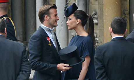 David Beckham and Victoria Beckham arrive to attend the Royal Wedding