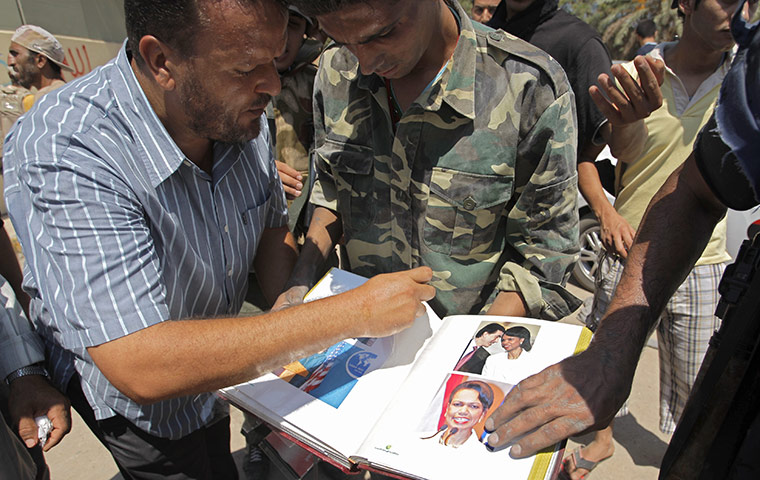album found inside Gaddafi's compound in Bab al-Aziziya showing photographs of Condoleezza Rice