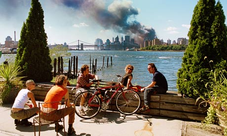 Young people chat as the World Trade Centre smokes in the background