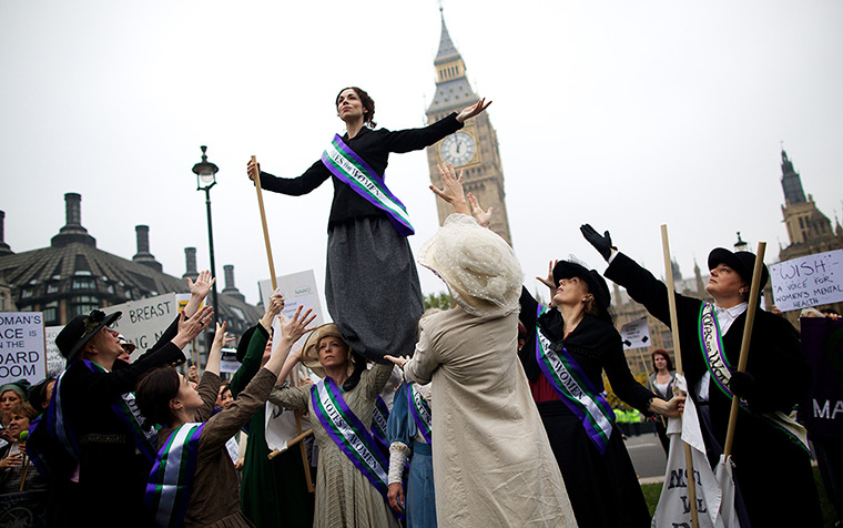 Sufragette march: Feminist activists dressed as The Suffragettes protest at Parliament Square