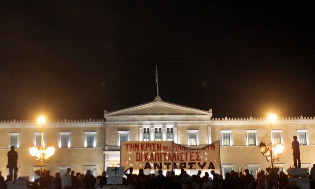 Protesters hold a banner reading