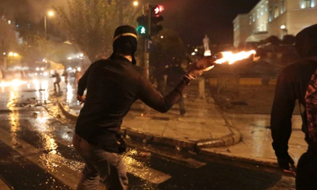 A protestor throws a molotov cocktail at riot police during a 48-hour strike by the two major Greek workers unions in central Athens November 7, 2012.