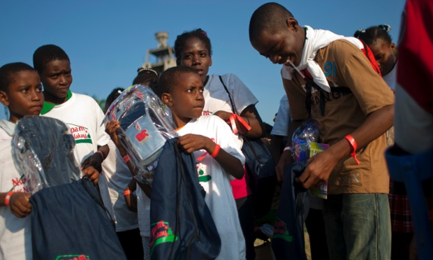 Children hold toys during a Christmas gift distribution event at the national palace in Port-au-Prince, Haiti.