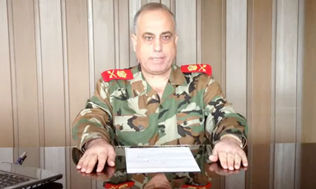 Syrian General Abdelaziz Jassim al-Shalal, making a statement for his defection