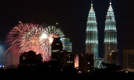 Fireworks explode near Malaysia's iconic Petronas Twin Towers in Kuala Lumpur