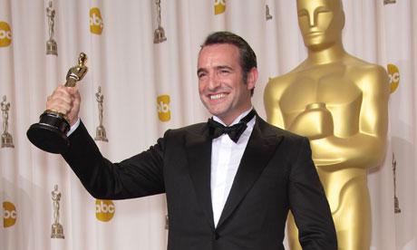 Jean Dujardin celebrates his triumph at the Oscars