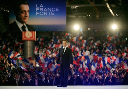 Sarkozy rally: Nicolas Sarkozy walks to the rostrum before making a speech
