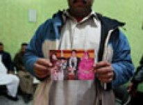 Relative holds a picture of Faizan Haider, a 21-year-old Pakistani killed by CIA agent Raymond Davis