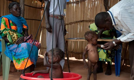 Aid workers assess child refugees from the Nuba mountains