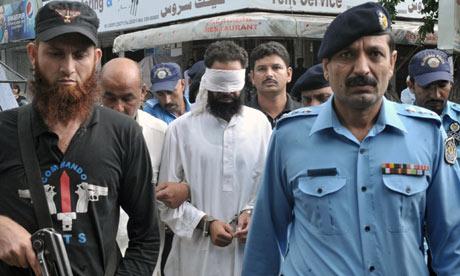 Pakistani policemen escort Islamic cleric