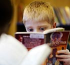 A boy reading in his school library