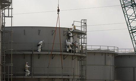 Workers constructing water tanks at Fukushima