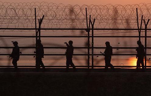 South Korean soldiers patrol inside the demilitatrised zone